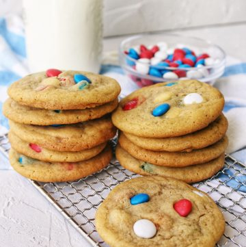 M&M cookies stacked with milk