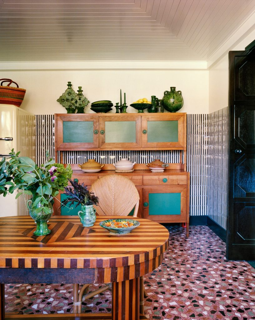 Inside Flamingo Estate, kitchen cabinets, dining table