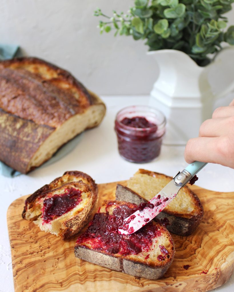 Spreading jam on homemade toast