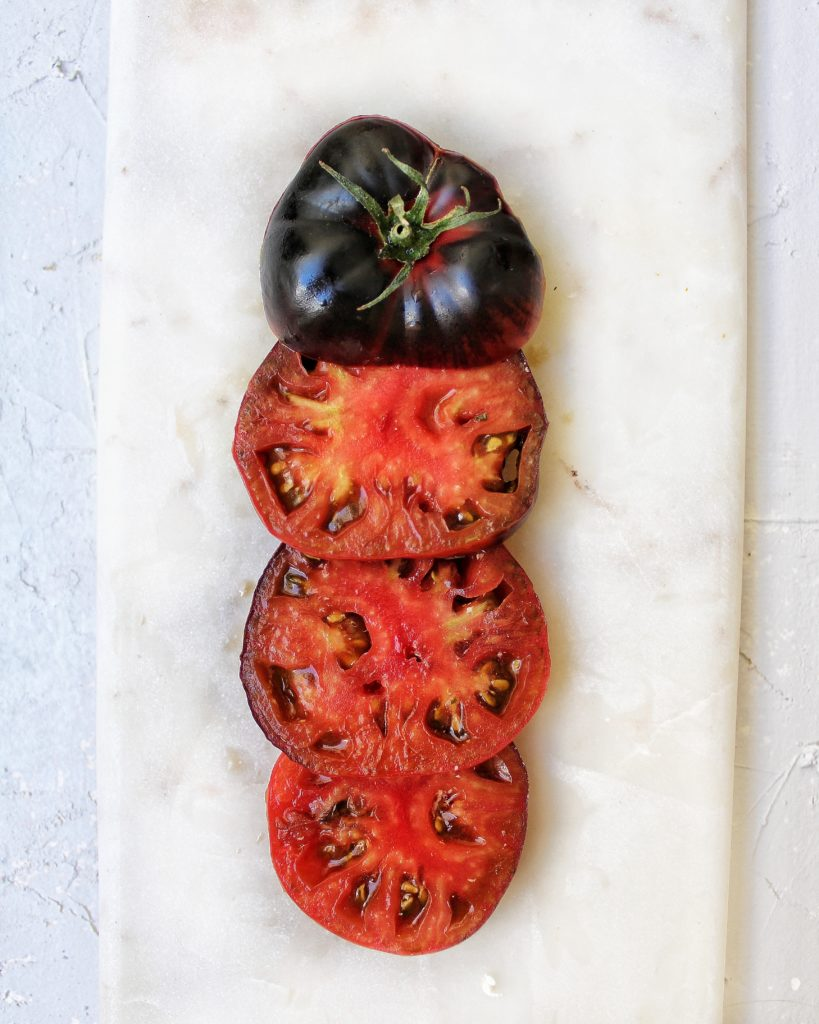 Black beauty tomato sliced