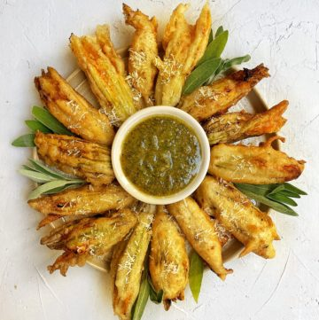 Fried zucchini blossom with sage walnut pesto