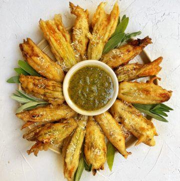 Fried zucchini blossom with sage walnut pesto