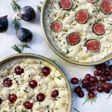 Unbaked focaccia with red grapes, fig, goat cheese, rosemary and honey