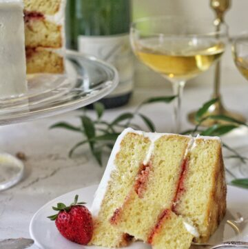Slice of Champagne elderflower cake with strawberry preserves
