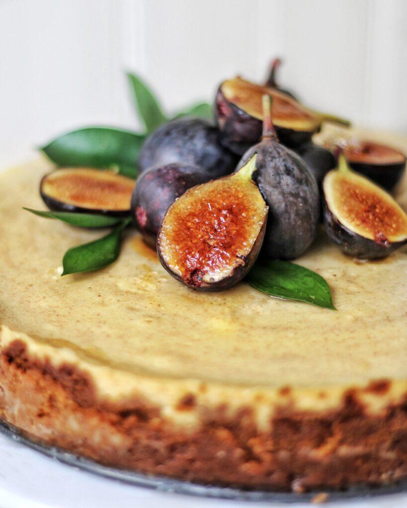 Cinnamon Mascarpone Cheesecake with BrûléedFigswith slice on plate