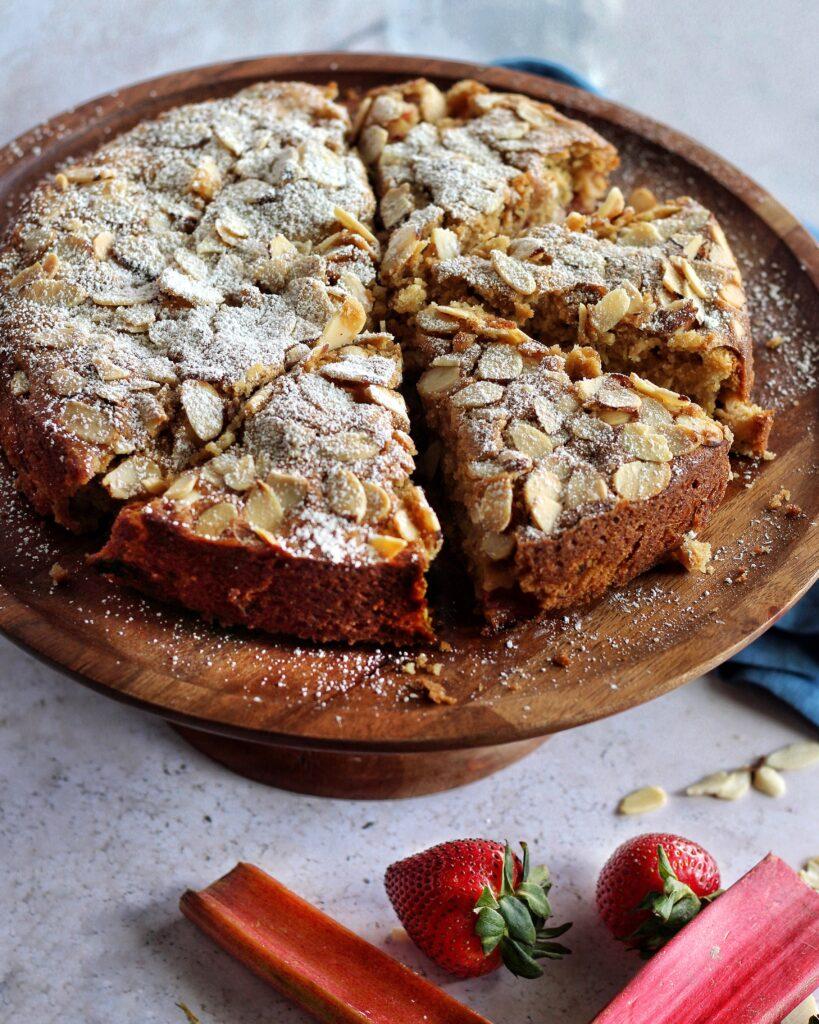 Strawberry rhubarb cake with sliced almonds, sliced